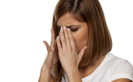 Picture of woman with sinus pain